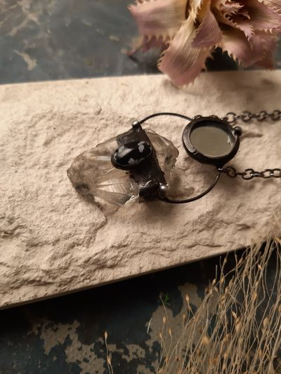 Necklace with Snow Obsidian, Raw Crystal and Mirror. $34.00