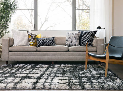 deep pile black and white rug with neutrals