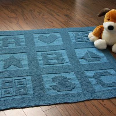 Sailboat Knitting Pattern Baby Blanket : Swathed in this blanket knit with the heavenly soft Knit ...