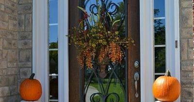 Fall decorations for the front porch and front door, using pumpkin topiaries, traditional and non-traditional decor. I love to use pumpkins of different colors.