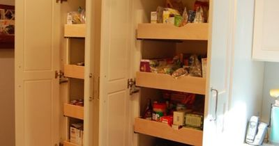 Pull out shelves in kitchen cabinets (pantry)...this would be great in a craft room!!