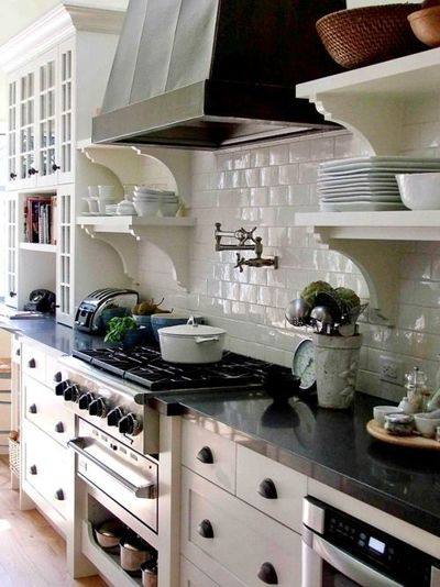 What a kitchen: open shelves, open slide out drawer below warming drawer, gorgeous hood