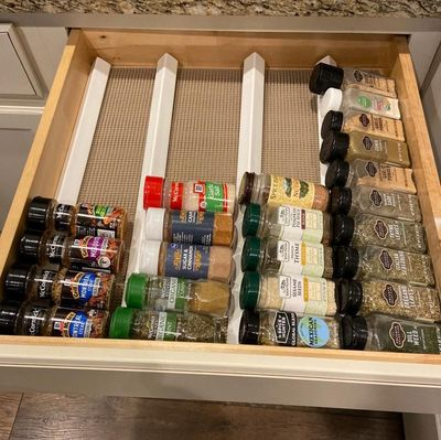 Spice Rack Organizer for Drawer - just uses corner moulding and a non-slip shelf liner