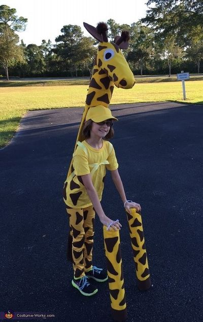 Colleen: My 10-year-old daughter Emily is wearing this giraffe costume that I made for her. It is made from recycled cardboard assembled with hot glue and cover