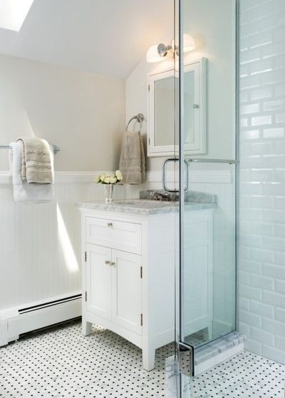 Lovely bathroom design with skylight, greige walls, chair rail with beadboard, Restoration Hardware Cartwright Powder Room Vanity Sink White with white carrara marble counter top, white mirror medicine cabinet, Pottery Barn Mercer Double Horizontal Sconce...