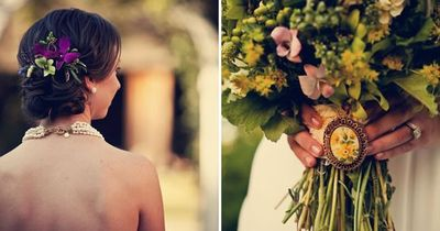 love the brooch on flower bouquet. could use a cameo