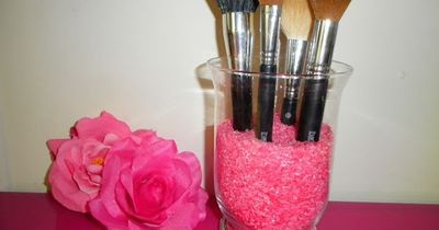 How to make colored rice... Put it in an old candle holder to make a cute makeup brush display (: