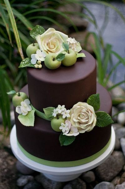 Chocolate wedding cake? Chocolate fondant with gumpaste roses, hydrangea, leaves, and jasmine. Plus marzipan apples!