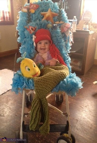 Billie: Our three month old daughter decided to go as her mother's favorite childhood movie character for Halloween this year, Ariel from the Little Mermaid. He
