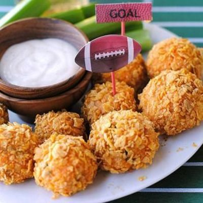 buffalo chicken bites - chicken, cream cheese & buffalo mixture rolled up and covered in crushed corn flakes and baked. Bite-sized Buffalo Chicken Bites that are oven baked, not fried! Perfect for snacking, appetizers, parties and tailgating.