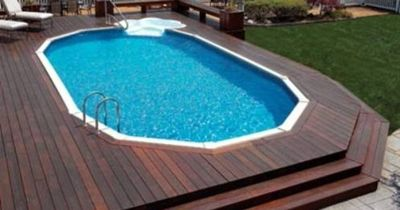 Above Ground Pool With Large Deck Built Up Around To Make