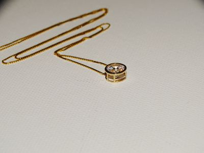 14k Yellow Gold Chain & Pendant Stamped, Sparkly 5mm Diameter CZ Stone necklace. $225.00