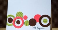 handmade greeting card ... die cut circles in various sizes and colors form a band running across the card ,, clean and simple layout ... lovely card ... could be a masculine card ,,,