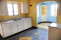Original!! kitchen interior of 1949 brick house. --love! Look at the great little corner cabinet in the dining room!