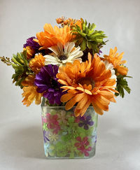 Flower arrangement in 3d faux stained glass vase $35.00