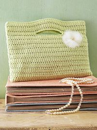 Crocheted purse made from a single crochet panel. The handle openings are formed by skipping stitches as you crochet the rows. Fold the panel in half and stitch the sides together to complete the clutch. Tutorial �œ��Š�Teresa Restegui http://www...