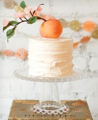 Top a simple buttercream cake with fresh fruit like a plump peach as an organic cake topper, like this gorgeous number from Emily at the vegan and gluten-free Lael Cakes!