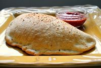 Homemade Calzones - This recipe makes two large calzones or four smaller ones that are filled with mozzarella, ricotta and all of your favorite pizza toppings.