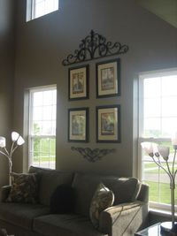 Two-Story Living Room, Our Two-Story Living Room is right off the main entrance of the house and shares with the Dining Room. Our loft also overlooks the Living Room. I added the three candle holders and grouping of artwork to take your eye up. We love si...