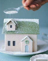 """Finished with a sprinkling of glitter """"snow,"""" this little homemade house is ready to join its neighbors in a shimmering holiday village."""