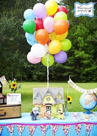 """View this incredible Disney's """"Up"""" party featuring a house cake, balloon wreath, fondant balloons, adventure in a suitcase & more."""