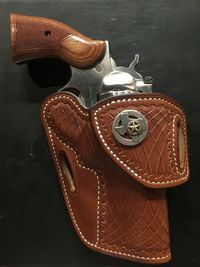 HF3 Revolver Holster by Tucker GunLeather.  HF3 is a revolver holster which can disappear even your largest revolver.The positive trait here for HF3 is it is made up of Hermann Oak vegetable-tanned cowhide.For further details,please visit:  http://www...