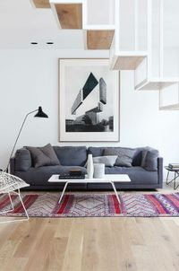 floating steel staircase, white walls, oak floors, grey sofa and oriental rug | by Haptic Architects: http://www.hapticarchitects.co.uk/2013/04/apartment-02-oslo.html | Photo by Inger Marie Grini