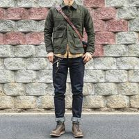 Green canvas jacket on blue denim w/boots