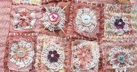 Textile Art Wall Hanging by Janice MacDougall. This hand embroidered wall hanging has been made with some hand dyed fabrics, threads and vintage crochet. It is embellished with embroidery, buttons, beads, ribbons, cotton lace and card flowers. The bottom ...