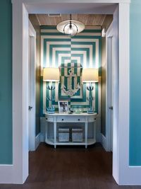 Browse a gallery of pictures that showcase the HGTV Smart Home 2013 foyer, a Hollywood Regency-style space that introduces the home's color palette and design s