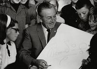 Walt Disney with young fans.