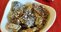 Chocolate and cashews top off a rich and butter cashew filled toffee. This is the best toffee recipe in the world.