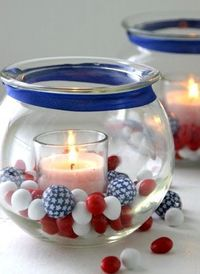 Easy Centerpiece Idea for the 4th or any holiday! Place a small votive inside a larger glass bowl and decorate with candies, ribbon, colored candles, etc. to match your holiday or celebration