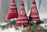"""Deck your halls in style and create some not-so-traditional """"sweater trees"""" from outgrown layers. These are perfect for your mantelpiece!"""