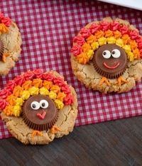 Peanut Butter Cup Turkey Cookies have a triple-shot of peanut butter - in the cookie, the cup and the frosting! #Thanksgiving #cookies