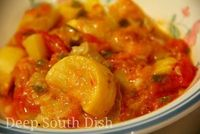 Squash Creole - Fresh squash and tomatoes are paired with Vidalia onion and sweet bell peppers, topped with cheese and buttered bread crumbs and baked.