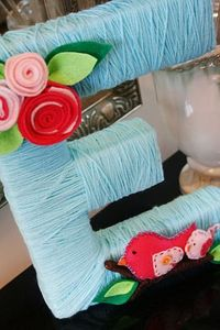 Love this sweet yarn monogram - and this post has lots of great baby shower ideas as well.