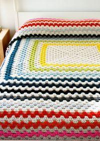 colorful tutorial for a super cozy, giant granny square blanket from The Purl Bee.