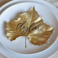 dried leaves, gold spray paint place cards.