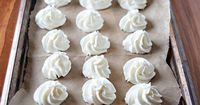 Frozen Whipped Cream Dollops - put them in your coffee or hot chocolate! With mixer on medium speed, beat 2 c. heavy cream into soft peaks. Add 2 Tbsp. confectioners' sugar and 1 tsp. vanilla extract, and beat until stiff peaks form. Transfer to pipin...