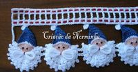 Photo tutorial for crocheted, embroidered Santa edging.