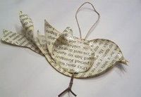 If you consider yourself a bookworm or simply like the look of printed text, you'll love this cute Baby Bird Book Page Ornament! While you typically think of or