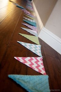 This 30 foot long fabric pennant banner brings some extra joy to my girls Fancy Room Makeover
