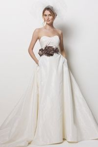 wedding dress with pockets! wouldn't do the colored flowers, but otherwise really pretty!