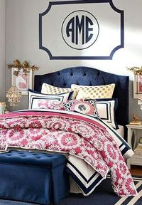 LOVE the monogram above the bed!! such an easy DIY - just have it printed on vinyl so you can remove it easily!