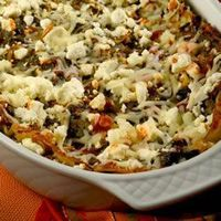 """Artichoke Spinach Lasagna. """"This is a fabulous lasagna made with an artichoke and spinach mixture which has been cooked with vegetable broth, onions and garlic. The mixture is layered with lasagna noodles, pasta sauce, mozzarella cheese, and topped w..."""