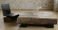 """Finally a wood coffee table that you don't have to worry about getting drink rings on. material: reclaimed hardwood, cherry. finish: natural, ebonized, dark brown. dimensions: 48"""" W x 48"""" L x 13"""" H."""