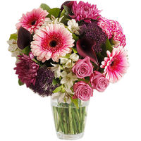 Luscious colours characterise this sumptuous bouquet. The depth and variation of colour, from deep purple to burgundy, of the purple calla lilies is so eye-catching and is echoed by the black hearts of the pink daisy-like gerberas