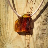 Birthday pendant from Amber for her and for him �'�40.00