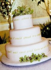 """Sweet Song This three-tiered cake (designed by the bride) features lyrics to the couple's wedding song -- Etta James' """"At Last."""" From the wedding of Amy and Jason in Orlando, Florida. Cake by Bake Me A Cake"""